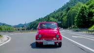 Red zastava car driving through the crossroads video