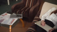 Redhead businesswoman lying on the sofa with laptop video