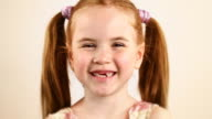 Redhead little girl laughing - HD, NTSC video
