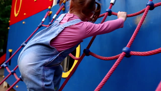 Redhead Little Girl Plays On Playground video