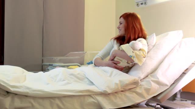 Redhead women with newborn baby video