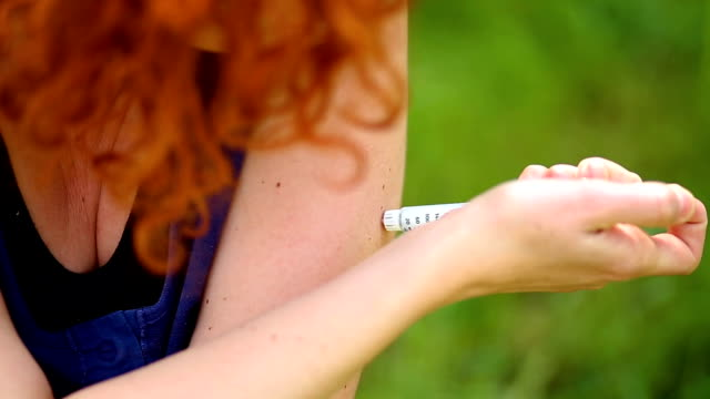 Redheaded Woman Making Arm Subcutaneous Insulin Syringe Injection video