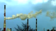 reek, smoke, fumes from industrial chimney video