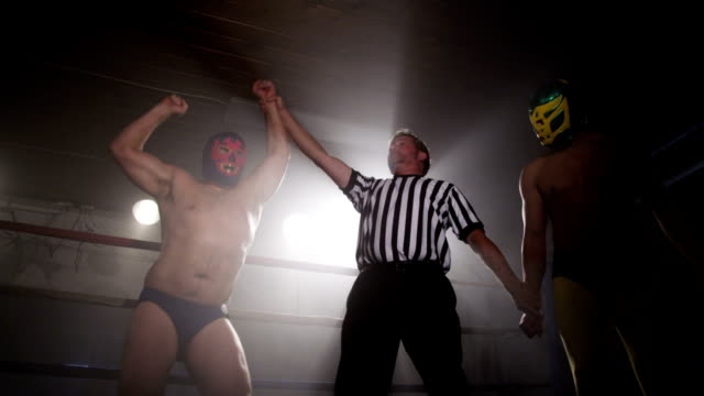 Referee announces winner of wrestling match video