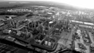 Refinery in the black and white  pollution in the Atmosphere sideways pan video