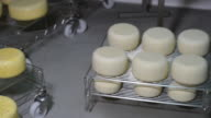 Refining cheese on wooden shelves video