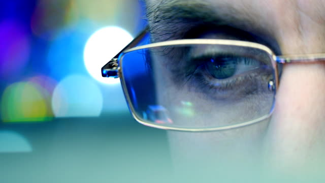 Reflection in the eye and glasses of the monitor when you surfing the Internet video
