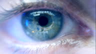 Reflection in the eye of the monitor when surfing the Internet. Extreme closeup video