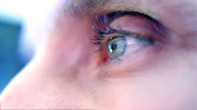 Reflection in the eye of the monitor when you  surfing the Internet. Closeup video