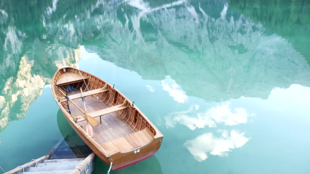 Reflection in water of mountain lakes and boats, Background, lake braies video