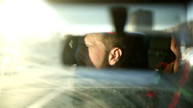 Reflection male face in the rearview mirror of the car video