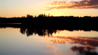 Reflection of beautiful sunset in forest lake with bird's songs video