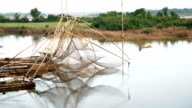 Chinese fishing nets in a river video