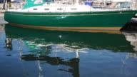 Reflection of Green Sailboat video