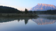Reflection of  Mount Rundle on lake, Banff National Park video