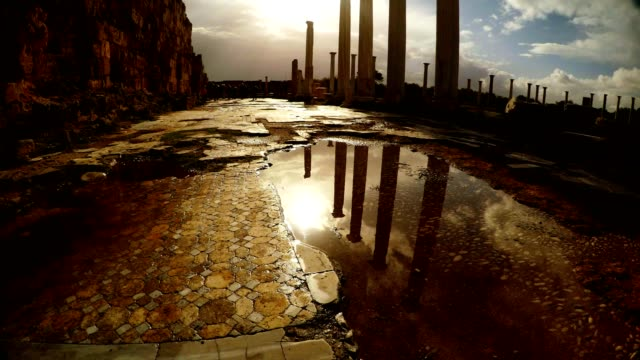 Reflections in water of columns of Roman Agora and sky with clouds antique town Salamis video