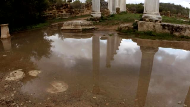 Reflections of columns in water stone hart ruins ancient town Salamis east Cyprus Famagusta video