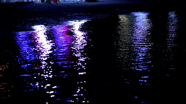 Reflections on the water at night. The path of light reflections video