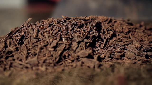 refocusing macro shot on pile of Chocolate chips video