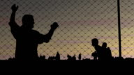 Refugees. Men and women and a fence. The concept of refugees video
