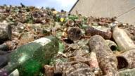 Refuse series - amber bottles on a heap, long pan video