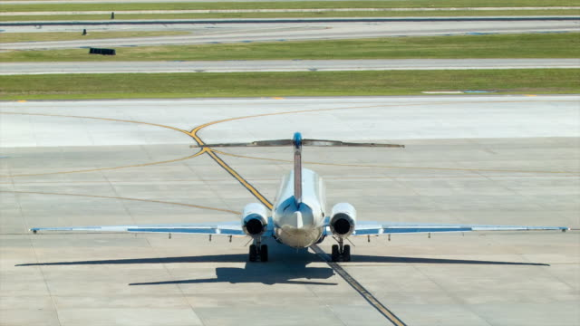 Regional Jet Airliner on Taxiway from Behind video