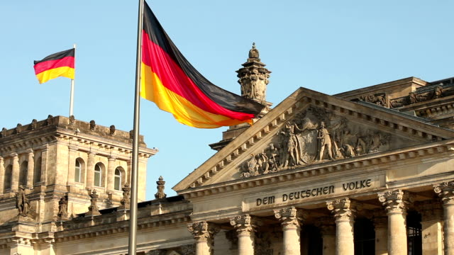 Reichstag in Berlin with two flaggs video
