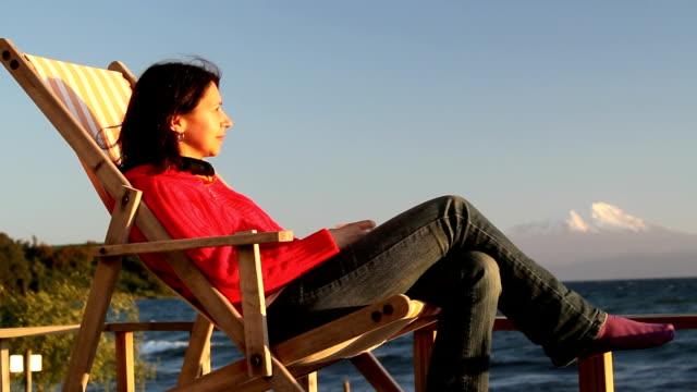 relax woman lake shore video