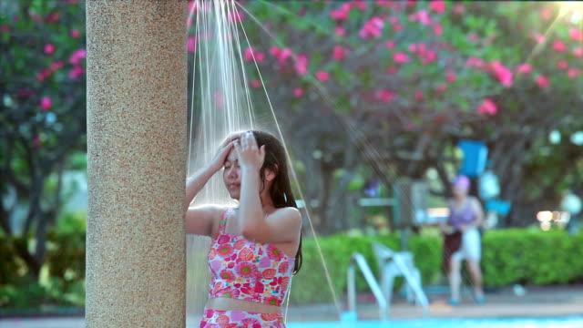 HD, Relaxed Asian girl teen in outdoor shower. video