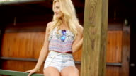 Relaxed blond woman wearing casual summer outfit video