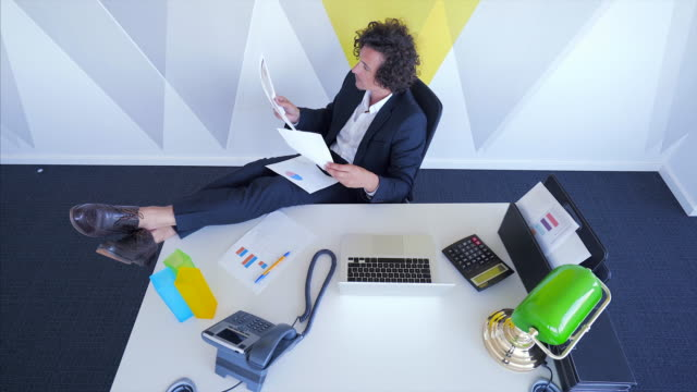 Relaxed businessman working in the office. video