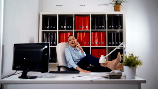 Relaxed businesswoman satisfied in office video