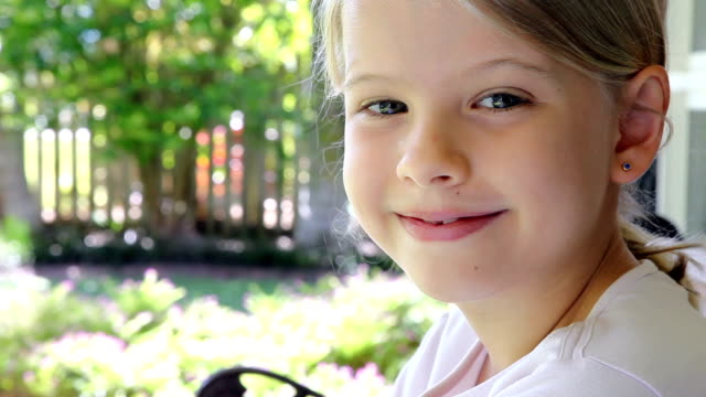 Relaxed little girl looking closeup video