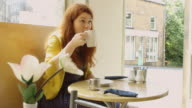 Relaxed Woman in Cafe video