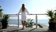 Relaxing in hotel balcony with scenic sea view video