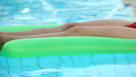 relaxing in water on an air mattress video