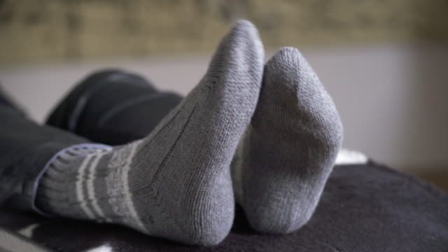 Relaxing Woman Rubbing Her Feet Together (4K/UHD) video