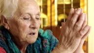 religious woman praying at home: christianity, God seeking, faith, catholic video