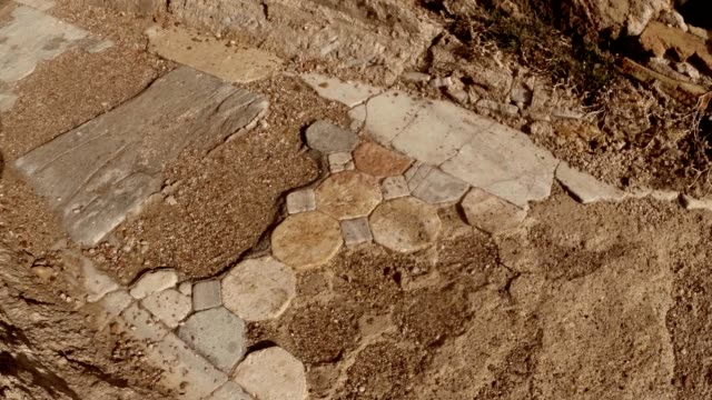 Remaining layings of marble tiles shadow walks antique town Salamis east Cyprus Famagusta video