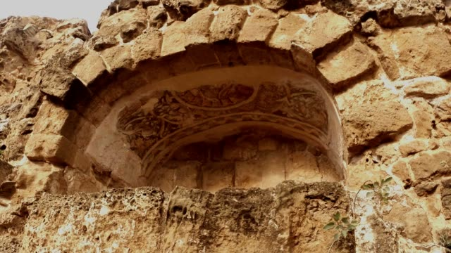 Remaining mosaics on arch ruins of antique town Salamis east Cyprus Famagusta video