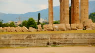 Remains of ancient Olympian Zeus Temple corner, modern Athens in background video