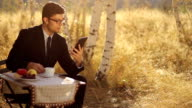 Remote Business  Young Man using tablet pc nature video