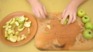 Removing apple kernels and cutting apples to slices video