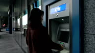 ATM removing card and money video