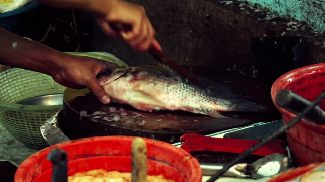 Removing Fish Scales in A Fish Market, video