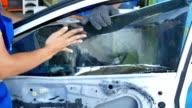 removing the broken car windshield video