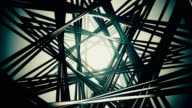 3D render, flying in a industrial tunnel, the abstract tunnel of metal structures and beams 4K video