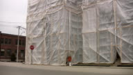 Renovation building wrapped in plastic. video