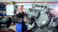 Repairer lifts the engine of the yacht by winch video