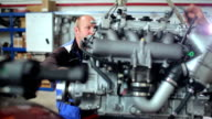 Repairers work on the engine at the yacht centre video